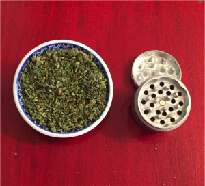 Greenito learn about marijuana and use a grinder